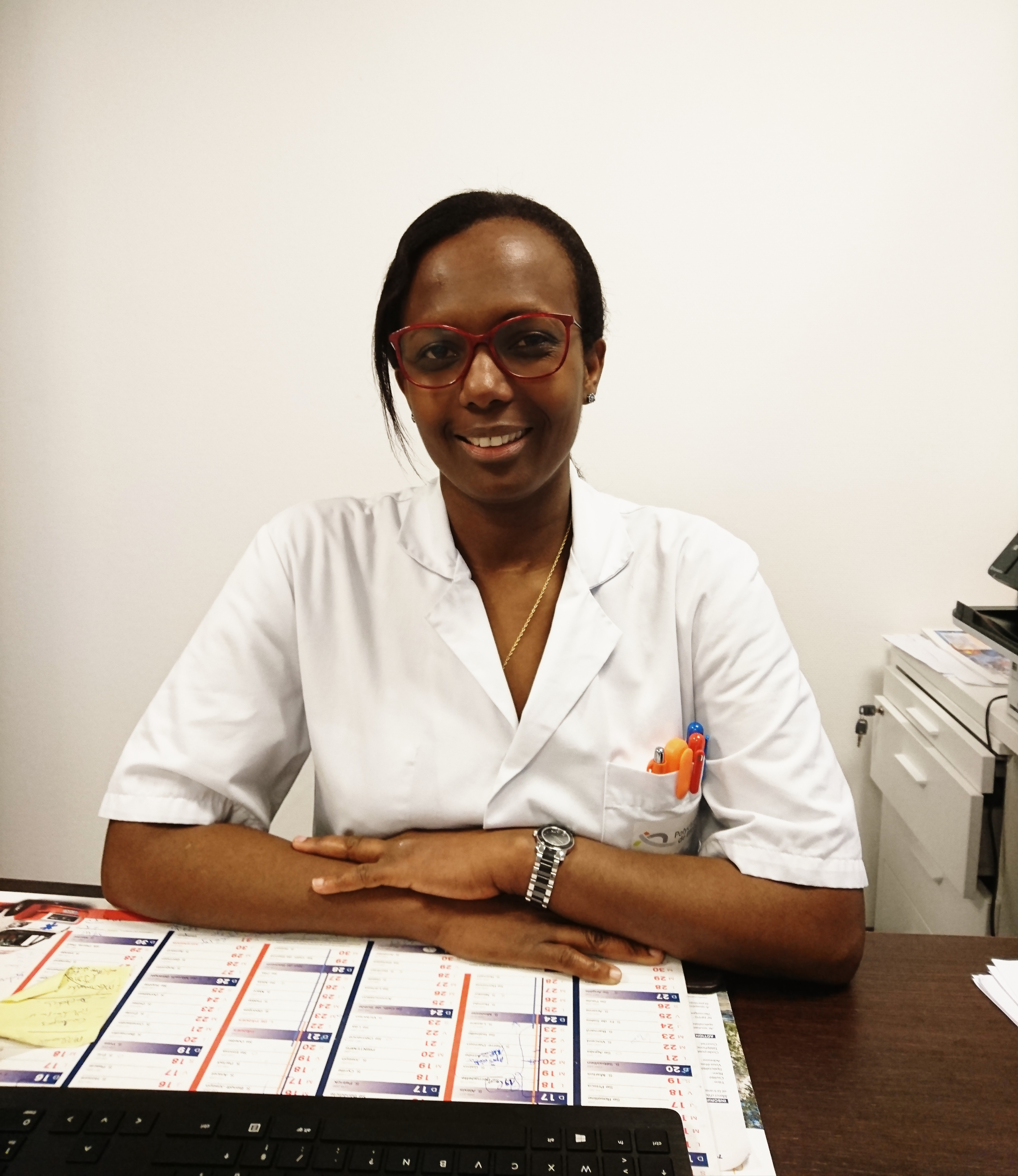 Dr Munega
